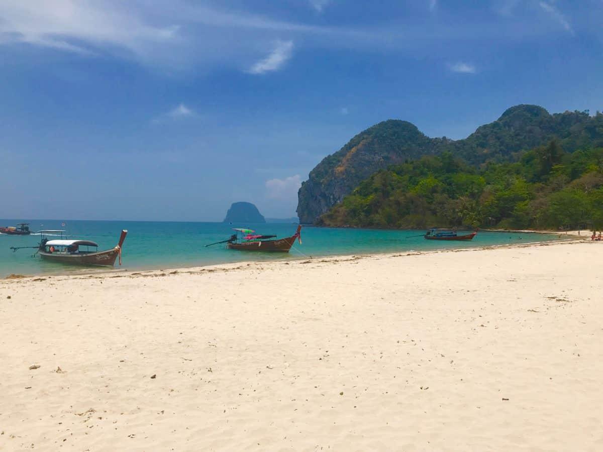 Longtail boat on sandy beach in Koh Mook