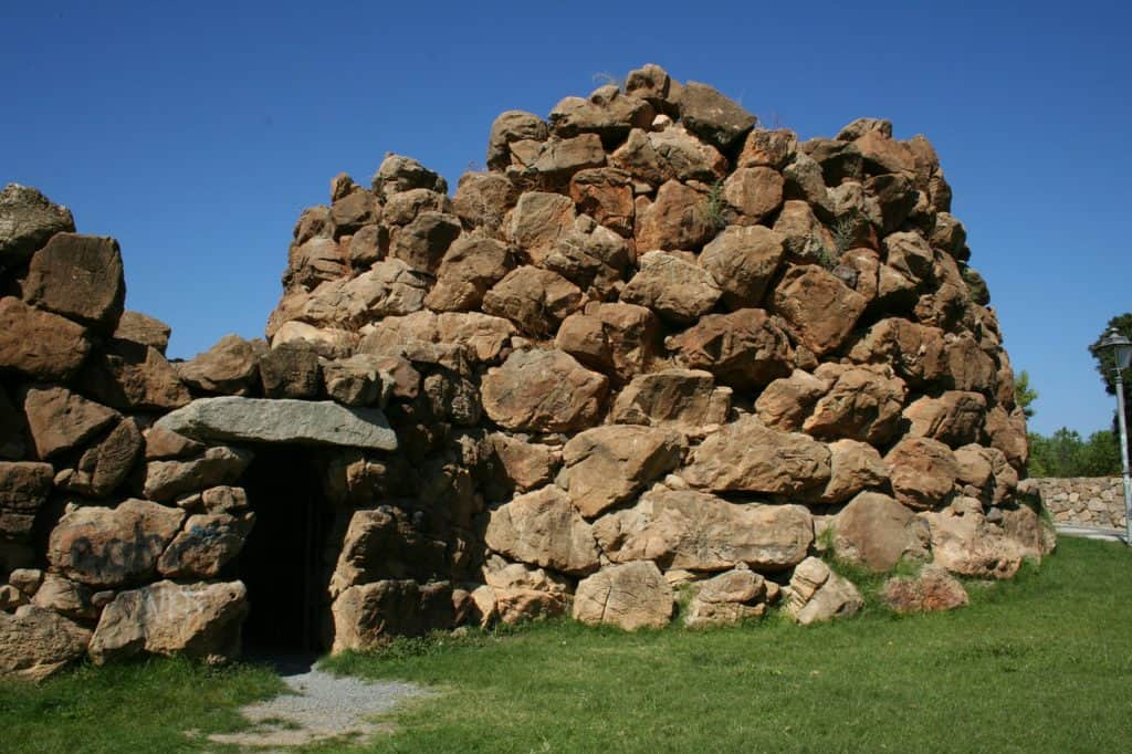 Image of ancient stone structure. Visiting a nuraghe is one of the best things to do in Alghero