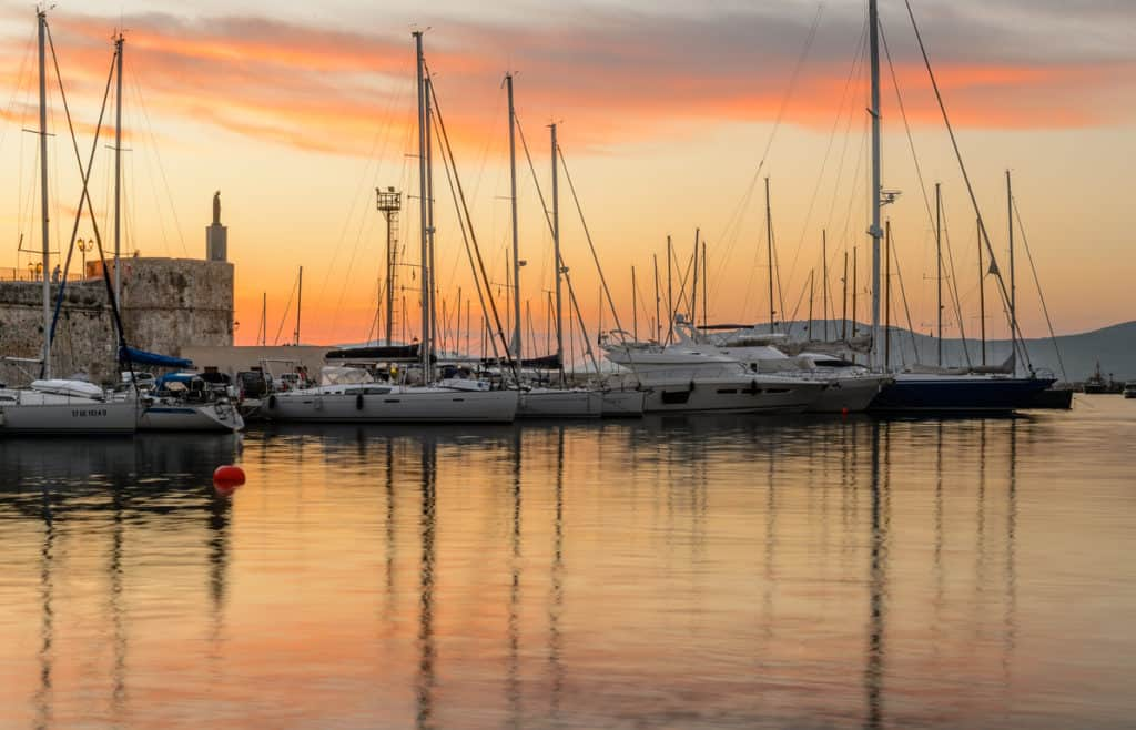 port of Alghero at sunset. An idea of where to go in Sardinia