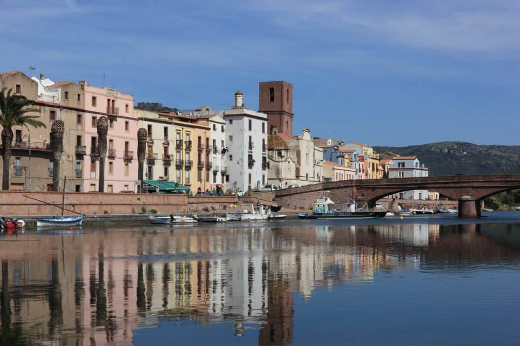 Image of the riverfront at Bosa. Visiting this town is one of the best things to do in Alghero