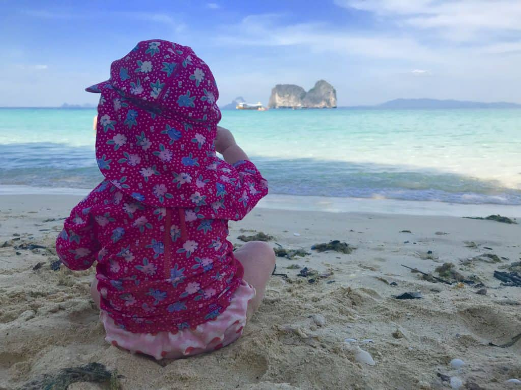 Island in Thailand with a baby sat on the beach