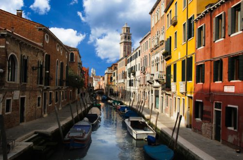 Venice side canal and colourful buildings. How many days in Venice is enough?