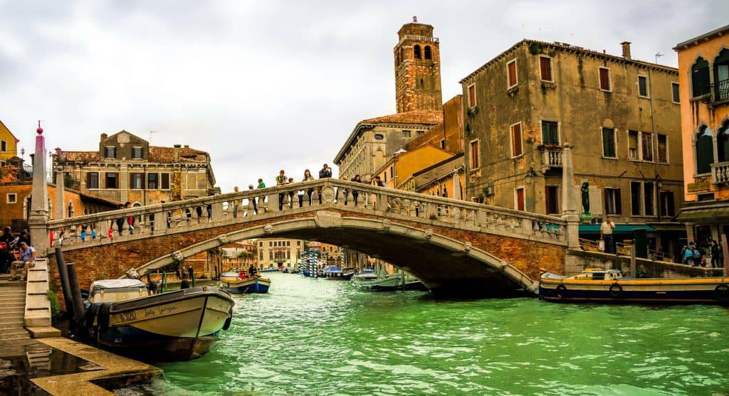Bridge over the Venice Grand Canal with church tower in the background. How many days in Venice?