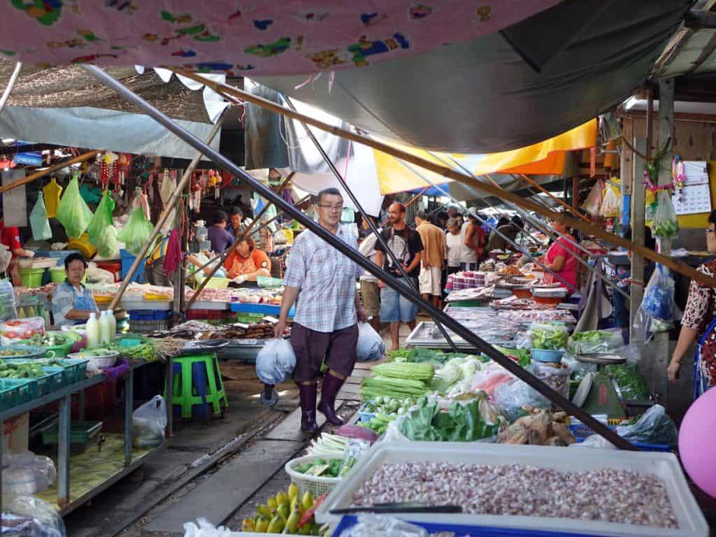 Man walking through the stall of Chatuchak Market oon a Bangkok 4 day itinerary