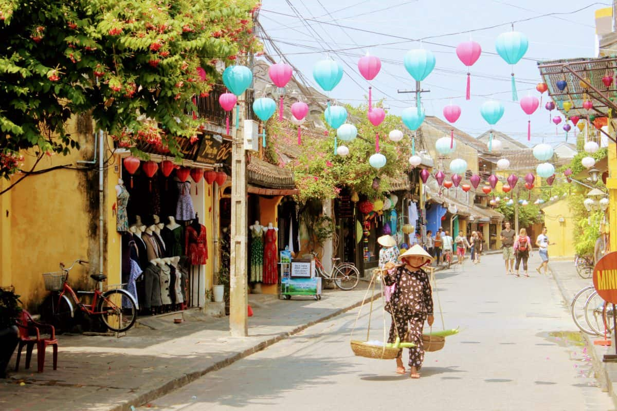 image of woman walking in the old town which is one of the best things to do in Hoi An with kids