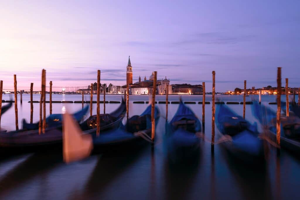 Gondolas in Venice with San Maggiorre in the backgroundat the end of a northern Italy itinerary