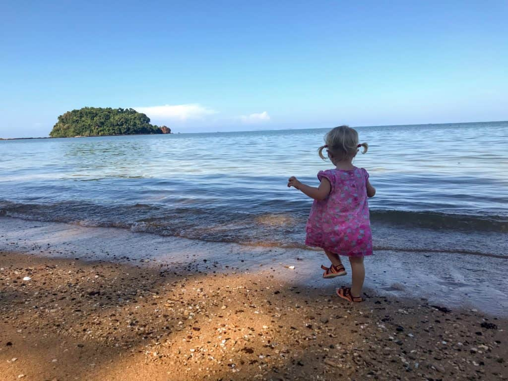 Young girl walking on the beach in Koh Libong with kids