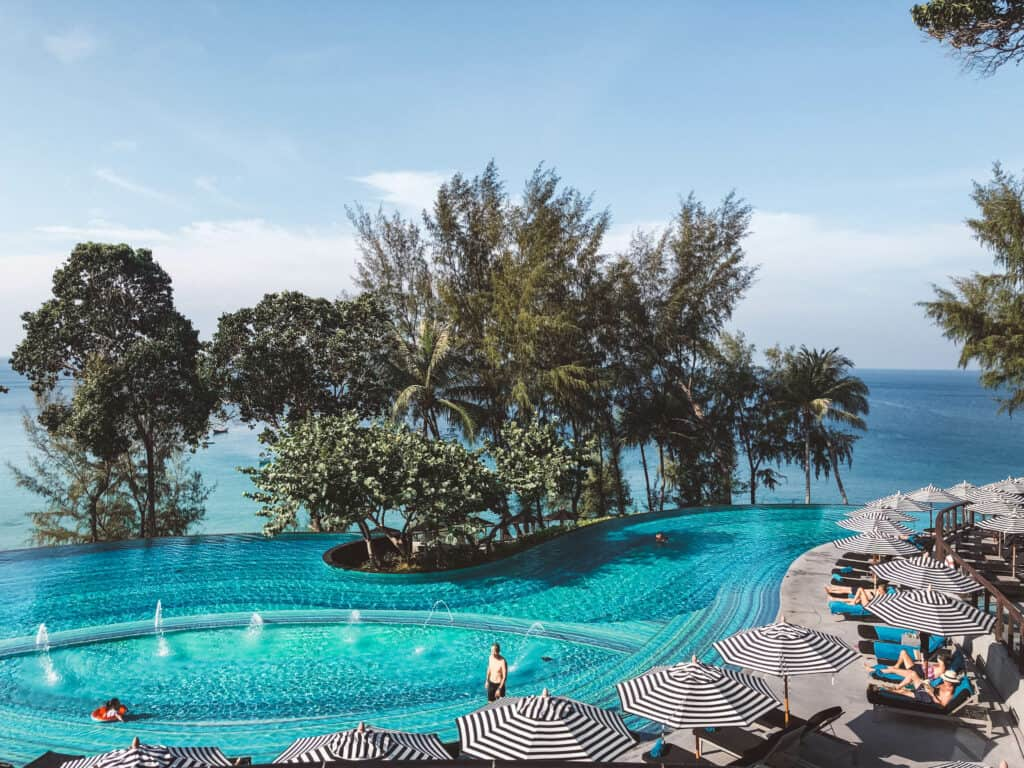 swimming pool with sea behind at Pullman Phuket Arcadia, one of the best family resorts Phuket