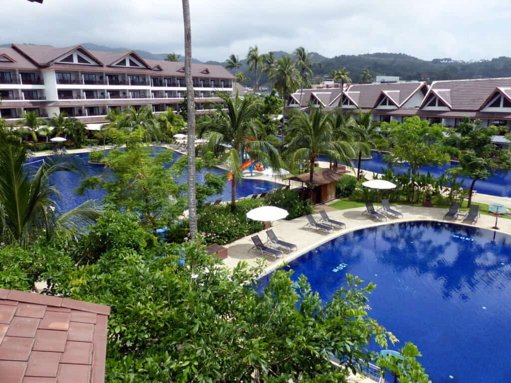 Vies across 2 swimming pools at Sunwing Kamala, one of the best family resorts Phuket