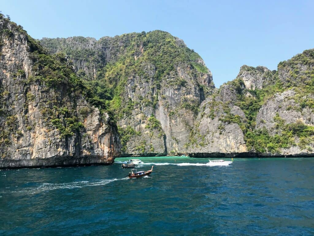 rocky Phi Phi island and boats when snorkelling from Koh Lanta