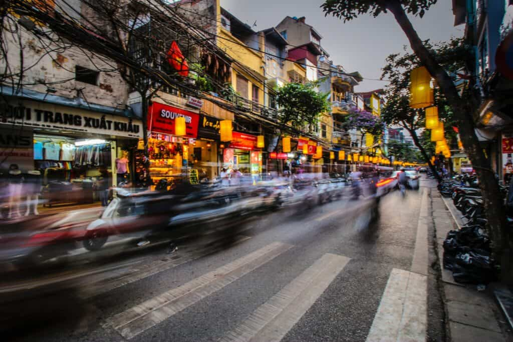 Hanoi street scene long exposure to produce blurred traffic. Hanoi is the start of our 10 day Vietnam itinerary