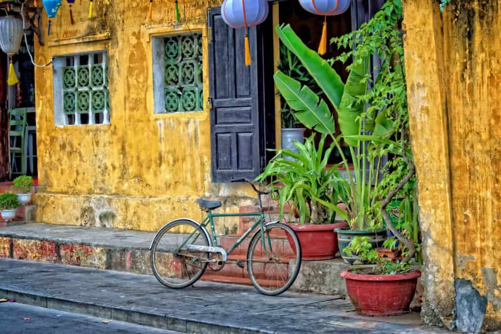 Bicycle against a yellow building in Hoi An, fianl stop on a 10 day Vietnam Itinerary