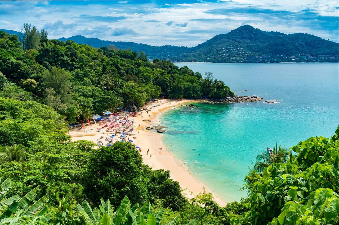 Aerial shot of beach and blue seas. One of th ebest places to visit in Phuket with Kids