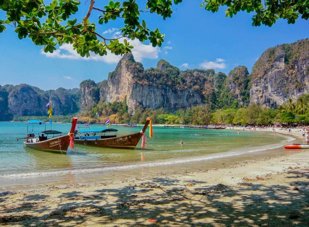 2 longtail boats at Railay Beach, of of the places to go in Krabi with Kids