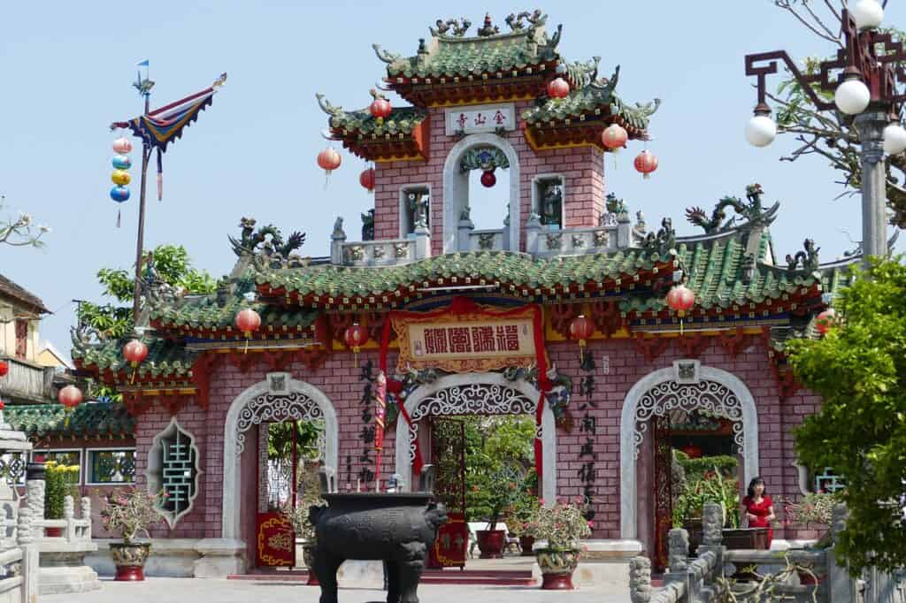 Where to Stay in Hoi An: Ornate japanese style pink temple gate with three archways