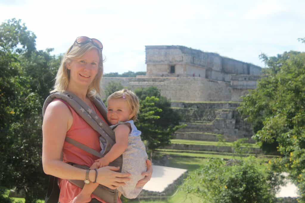 woman with baby in carrier infornt of Mayan ruins.Ergo vs Tula Carriers